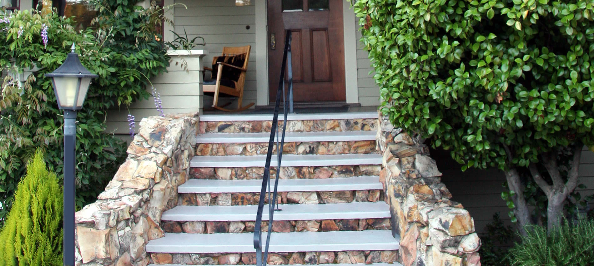 about eureka street inn and the stone steps that lead to the expansive sitting porch